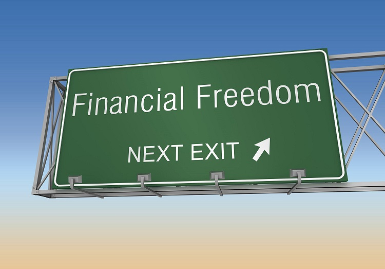 a highway sign indicating the direction to financial freedom